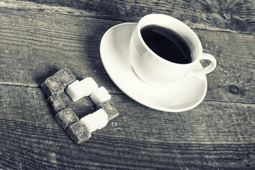Photo of coffee cup and sugar heart