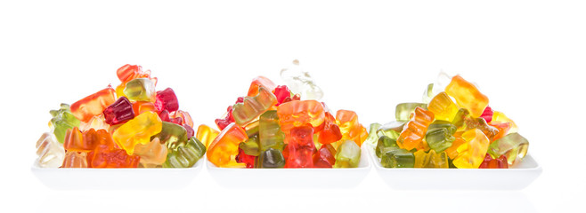 Heap of Gummi Bears isolated on white