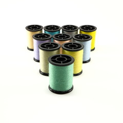 Multiple spools of vividly colorful fuzzy thread