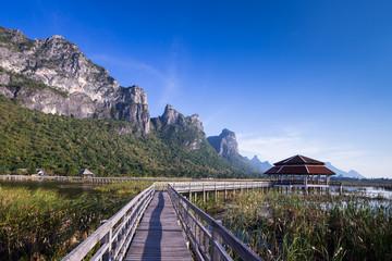 Wooden bridge over a lake in Sam Roi Yod National Park, Prachuap