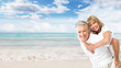 Happy senior couple on the beach.