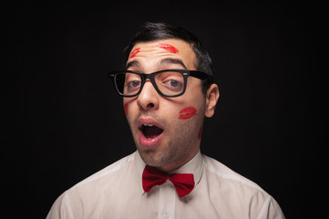 Funny portrait of young nerd with kiss imprints