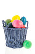 Colorful painted easter eggs in basket