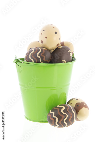 Chocolate eggs in green bucket