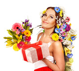 Woman with gift box and flower bouquet .