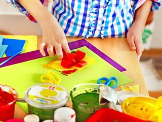 Child making decoration card..