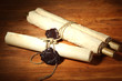 Old scrolls, on wooden background