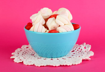 Gentle marshmallow in bowl on pink background
