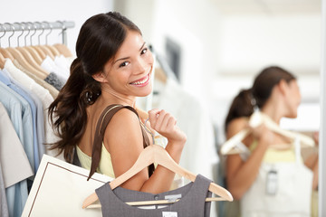 Happy shopping woman in clothing store