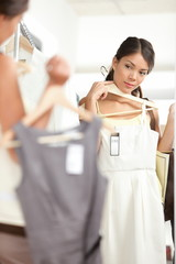 Woman shopping choosing dresses