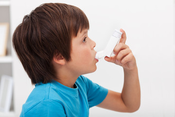Boy using inhaler