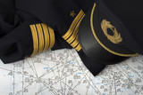 captain uniform over an aeronautical navigation chart