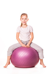 Sportive girl on a fit ball