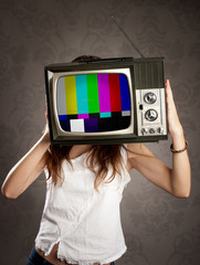 woman holding old television on her head