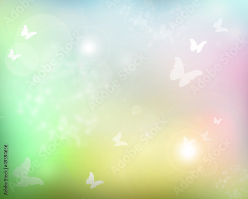 Sunshine with butterflies as abstract lights background