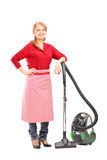 Full length portrait of a blond housewife posing on a vacuum cle