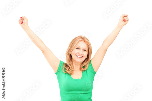 Beautiful mature woman gesturing happiness