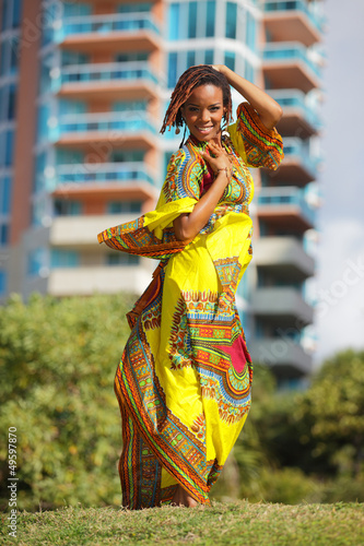 Stock image of a woman posing in an African dress