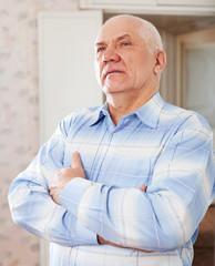 wistful grizzled elderly man