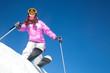 girl on mountain skiing