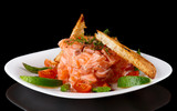 Salmon carpaccio in plate isolated on black