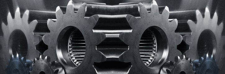 gears and cogwheels panoramic mirror image in blue toning
