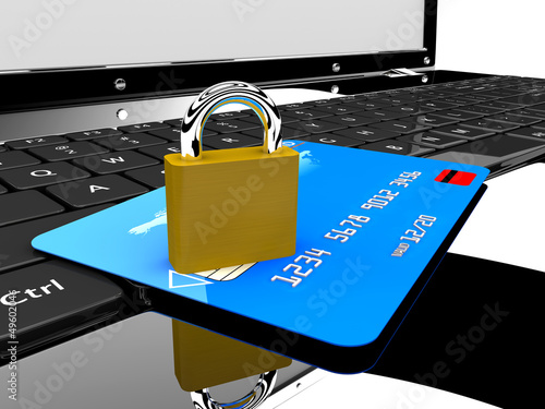 Credit card and lock on laptop