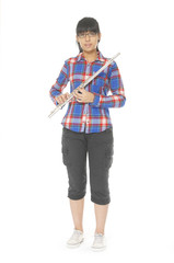 Full length of view of a young girl playing the flute