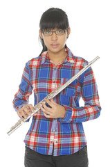 Portrait of a cute girl play in flute. Isolated