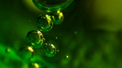 Small bubbles in green gel. Extreme macro.