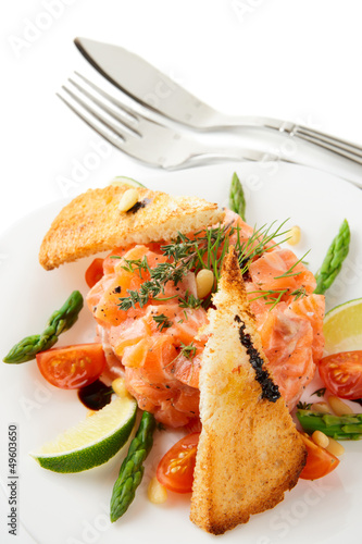 Salmon carpaccio in plate
