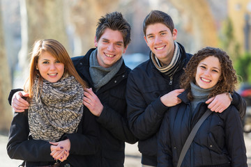 Group of Friends Embraced Outdoor