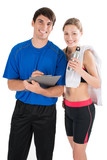 Personal trainer and customer checking workout results