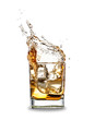 Whiskey splashing out of glass, isolated on white background