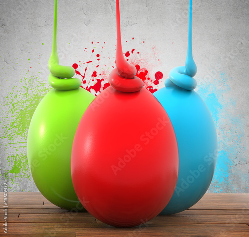 Three colorful eggs on a wooden planks