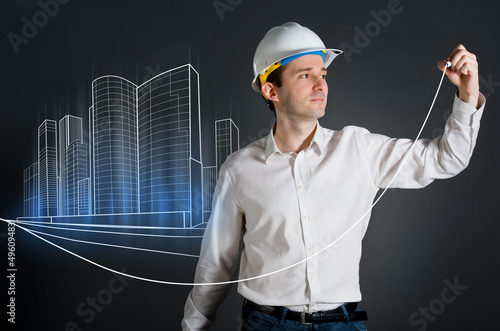 Architect drawing an urban city blueprint
