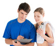 Personal trainer and customer evaluating workout results