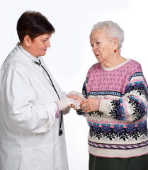 Old woman having discussion with her doctor