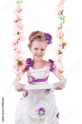 Pretty little girl near pink floral swing isolated