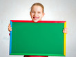 Cute girl holding a blackboard
