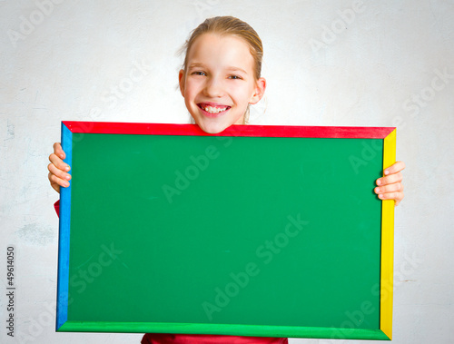 Cute girl holding a blackboard