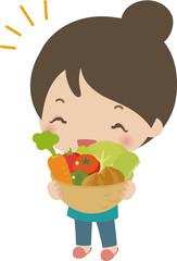 たくさんの野菜を持った笑顔の女性