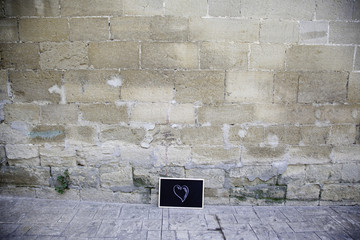 Blackboard on wall with heart