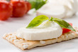 Caprese su crackers - Caprese on crackers, selective focus