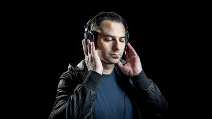 man with headphones listening music