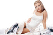 The pregnant woman sits isolated