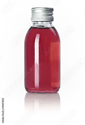 Full and closed bottle with red liquid