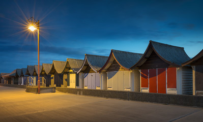 Beach Huts at Night at Mablethorpe, Lincolnshire, UK.