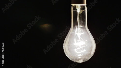 Real light bulb turning on, flickering and turning off
