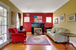 Living room with red and yellow walls and fireplace.